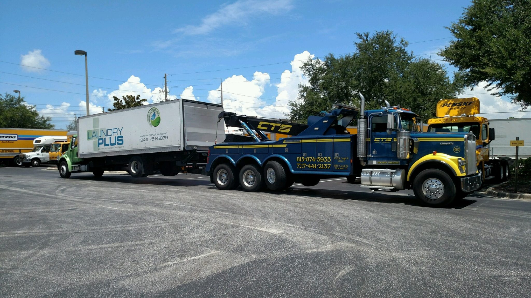 Heavy box truck tow by CTS Towing