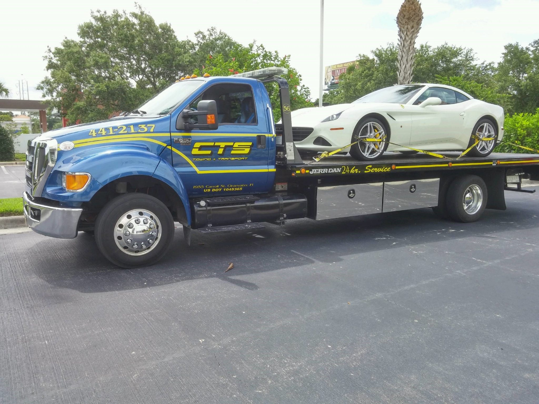 Ferrari California on a rollback CTS Tow Truck