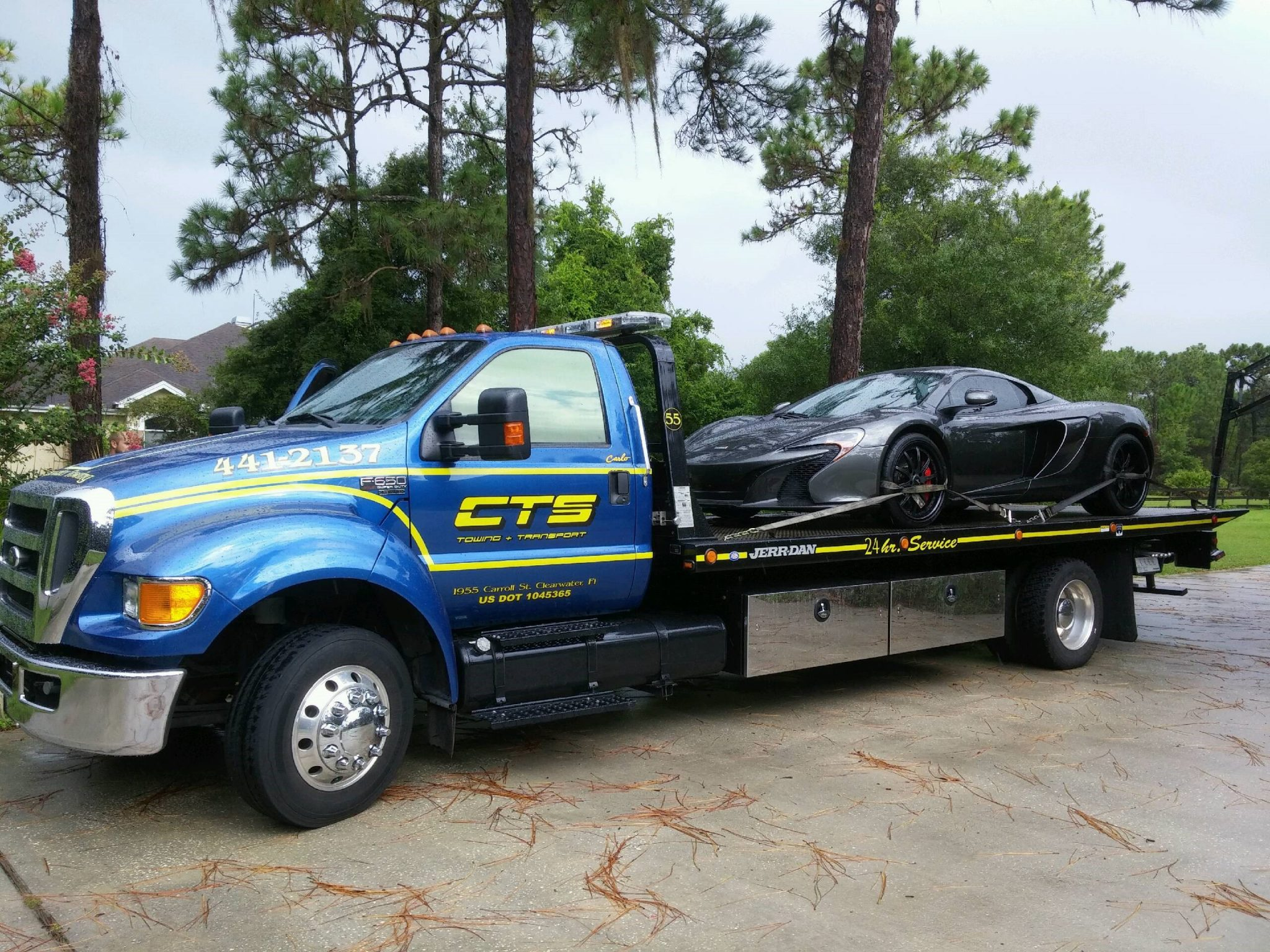 Rollback Maclaren 650S on a rollback CTS Tow Truck