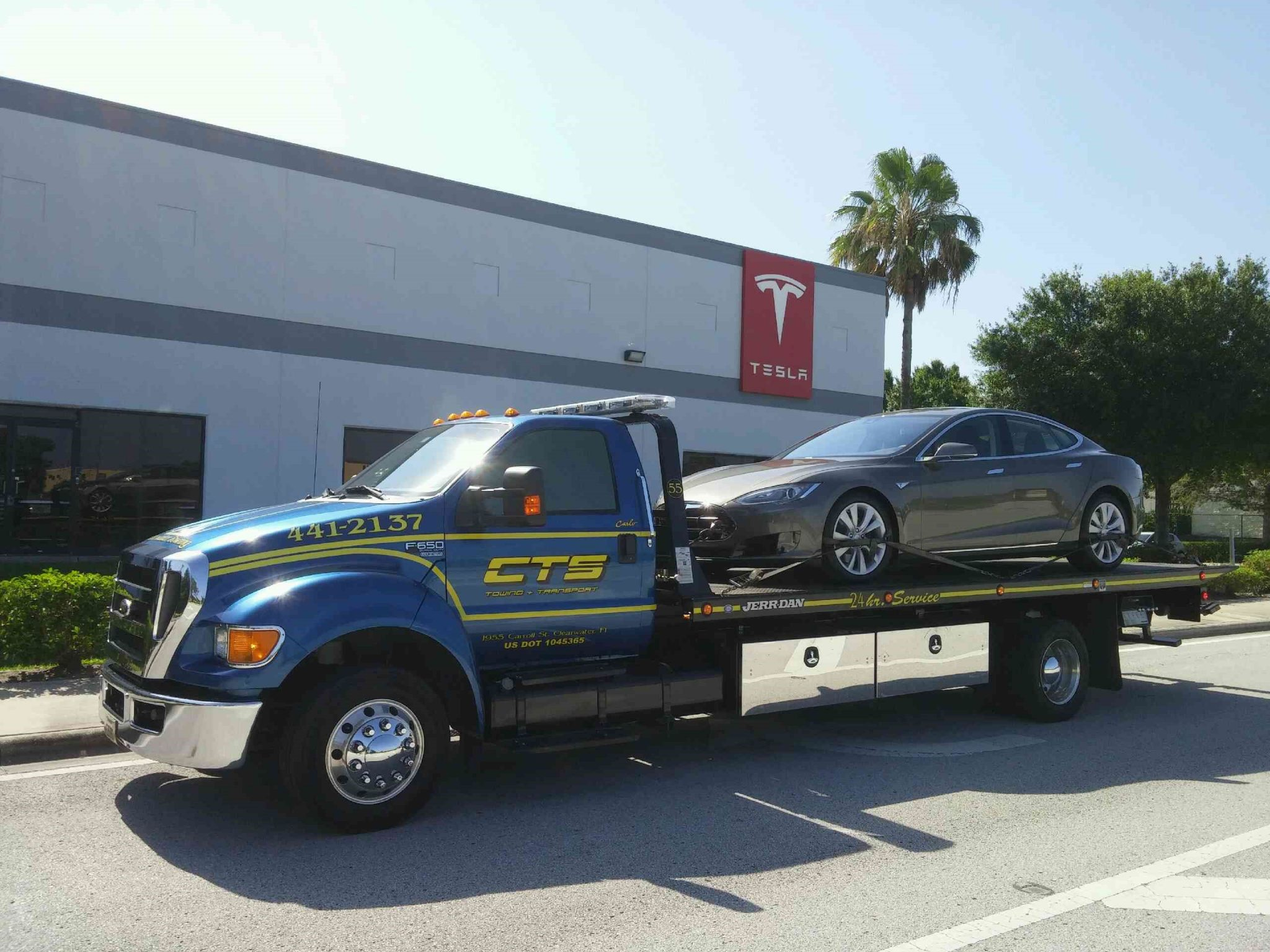 Rollback Tesla on a rollback CTS Tow Truck